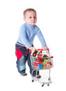 Boy and shopping plays with trolley toys isolated on white Royalty Free Stock Image