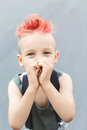 A boy shows his heart with his hands. A little boy with red hair. Child in uniform. The child indulges, croaks. Royalty Free Stock Photo
