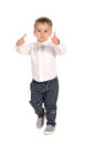 Boy shows ok in white shirt and gray trousers isolated on white background Stock Image