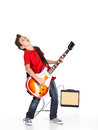 Boy sings and plays on the electric guitar Royalty Free Stock Image