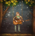 The boy sits on the swing in the forest and plays on guitar Royalty Free Stock Photo