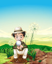 A boy sitting above a stump holding a magnifying lens Royalty Free Stock Photo