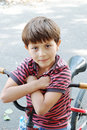 The boy sitting on a bicycle Stock Image