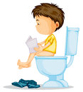 A boy sitting on commode Stock Photos