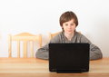 Boy sitting with a computer Royalty Free Stock Photo
