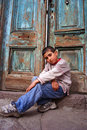 A boy sitting at the doorstep Stock Images
