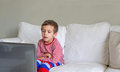 Boy sitting in front of computer Royalty Free Stock Photo