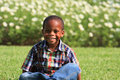 Boy Sitting on Grass Royalty Free Stock Photo