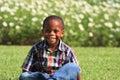 Boy Sitting on Grass Royalty Free Stock Photo