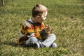 Boy sitting on the grass Royalty Free Stock Photo
