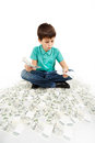 Boy sitting on money concept how to be successful isolated white background Stock Photography