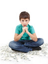 Boy sitting on money concept how to be successful white background Stock Photography