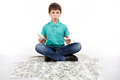 Boy sitting on money money concept how to be successful isolated white background Royalty Free Stock Photo