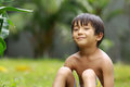 Boy sitting in the park Stock Photography