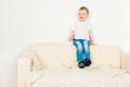 Boy sitting on sofa Stock Image