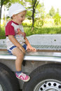 Boy sitting on trailer Royalty Free Stock Photo