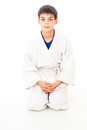 Boy sitting waiting to fight Stock Photo