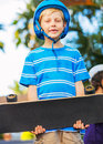Boy with skate board cute young Stock Images