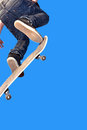 Skaterboy with skateboard is going airborne Royalty Free Stock Photo
