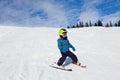 Boy In Ski Mask Skiing On Snow...