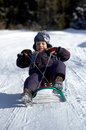 Boy on sled Stock Photo