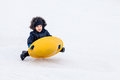 Boy sleigh sledding winter time Royalty Free Stock Photos