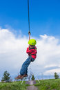 Boy sliding on zip line young in adventure park Royalty Free Stock Images