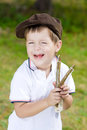 Boy with slingshot in summer Royalty Free Stock Images
