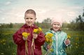 Boy and small girl  on meadow Royalty Free Stock Photo