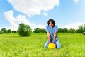 Boy with soccer ball portrait of years old sit on the field on bright sunny day Stock Photos