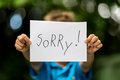 Boy with Sorry sign Royalty Free Stock Photo