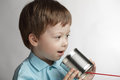 Boy speak in tin can telephone Stock Photo