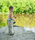 Boy with spinning rod little fisherman Royalty Free Stock Images