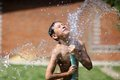 Boy with splash water in hot summer day Royalty Free Stock Photo