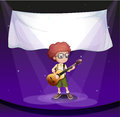 A boy at the stage with an empty banner at the back Stock Photos