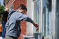 Boy stainning window on the outside. Stock Photos