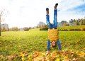 Boy stand on hands on the lawn Royalty Free Stock Photo
