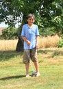 Boy standing above sprinkler Royalty Free Stock Photo
