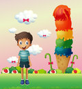 A boy standing near the big ice cream illustration of Royalty Free Stock Photography