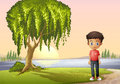 A boy standing near the giant tree illustration of Stock Photo
