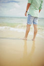 Boy standing in sea on bournemouth beach a stands the s sandy the uk Royalty Free Stock Images