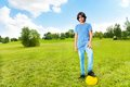 Boy standing with soccer ball Royalty Free Stock Photo