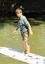 Boy standing on surf Royalty Free Stock Photo