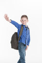 Boy standing and waving hand on white. Royalty Free Stock Photo