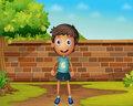 Boy standing in the yard Royalty Free Stock Photography
