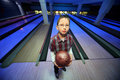 Boy stands with ball for bowling Royalty Free Stock Images