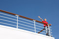 Boy stands at railing on deck of ship Royalty Free Stock Photo