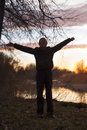 Boy stands in the sunset Royalty Free Stock Photo