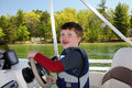 Boy Steering Boat Royalty Free Stock Photo