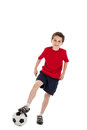 Boy stepping on soccer ball year old a in the air isolated white background Stock Photography
